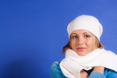 Young  woman on  blue background Royalty Free Stock Photo
