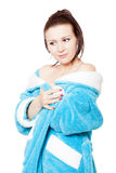 Young woman in blue bathrobe with naked shoulders Stock Image
