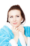 Young woman in blue bathrobe surprised look Royalty Free Stock Photo