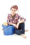 Young woman with blue bucket in headscarf Royalty Free Stock Photography