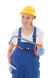 Young woman in blue builder uniform with saw isolated on white Stock Photos