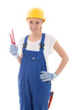 Young woman in blue builder uniform with screwdrivers isolated o Royalty Free Stock Photography