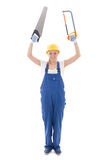 Young woman in blue builder uniform with two saw isolated on whi Stock Image