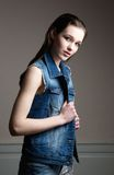 Young woman in blue denim jacket Stock Photos