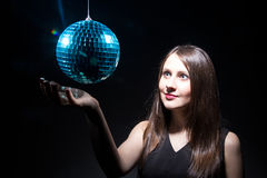 Young woman and blue disco ball Royalty Free Stock Images