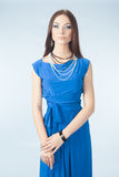 Young woman in blue dress. Posing in studio Stock Images