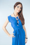 Young woman in blue dress. Posing in studio Stock Photography