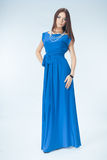 Young woman in blue dress. Posing in studio Royalty Free Stock Image
