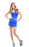 Young woman in blue dress posing Royalty Free Stock Photos