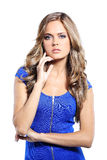 Young woman in blue dress posing. In studio Royalty Free Stock Images