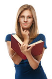 Young woman in blue dress reads red book Royalty Free Stock Image
