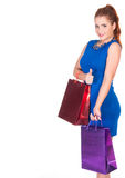 Young woman in blue dress with shopping bags Stock Images