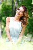 Young woman in blue dress sitting on grass Royalty Free Stock Photos