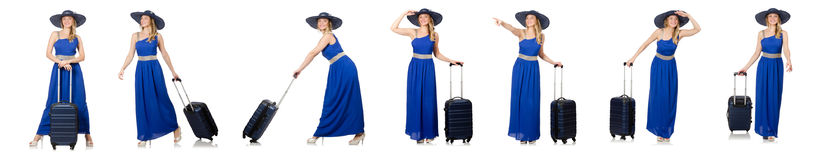 The young woman in blue dress and suitcase isolated on white Royalty Free Stock Photography