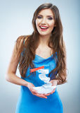 Young woman in blue evening dress hold white paper ship. Stock Photos