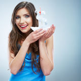 Young woman in blue evening dress hold white paper ship. Royalty Free Stock Photo