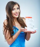 Young woman in blue evening dress hold white paper ship. Stock Photo