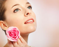 Young woman with blue eyes holding a rose royalty free stock photos