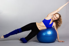 Young woman with blue fit-ball Stock Image