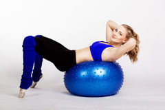Young woman with blue fit-ball Royalty Free Stock Photo