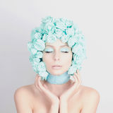 Young woman with blue flowers hair Royalty Free Stock Image