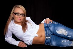 Young woman in blue jeans and a white top Royalty Free Stock Image
