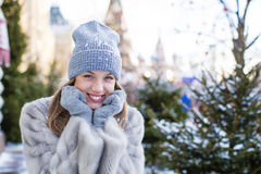 Young woman in a blue knitted hat and gray mink coat Royalty Free Stock Images