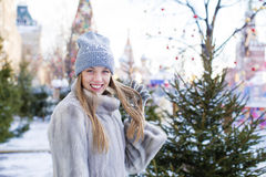 Young woman in a blue knitted hat and gray mink coat Royalty Free Stock Photos