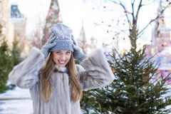 Young woman in a blue knitted hat and gray mink coat Stock Photography