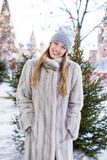 Young woman in a blue knitted hat and gray mink coat Royalty Free Stock Photography