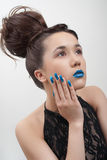 Young woman with blue lips and nails Stock Photos