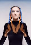 Young woman with blue and orange ribbons in hair Royalty Free Stock Image