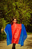Supporter woman with blue and red flag. Supporter young woman with blue and red flag stock images
