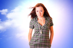 Young woman and blue sky Royalty Free Stock Photo