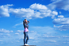 Young woman in the blue sky Stock Image