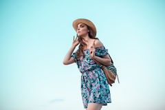 Young woman and blue sky Royalty Free Stock Images