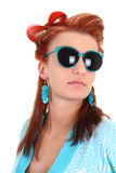 Young woman with blue sunglasses Stock Photography
