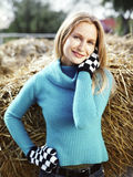 Young woman in a blue sweater in the countryside Royalty Free Stock Images