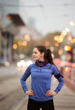 Young woman in blue sweatshirt running in the city Royalty Free Stock Photo