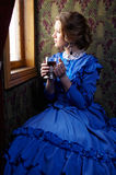 Young woman in blue vintage dress  sitting in coupe of retro rai Stock Image