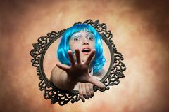 Woman in blue wig Royalty Free Stock Image