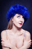 Young woman in blue winter hat Royalty Free Stock Photography