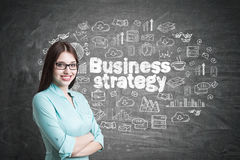 Young woman in blueish shirt, strategy Stock Image