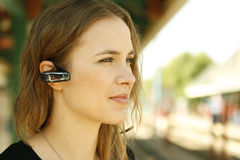 Young woman bluetooth headset Stock Photography