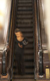Woman in old escalator Royalty Free Stock Photos