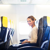 Young woman  on board of an airplane Royalty Free Stock Photo