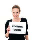 Young woman with board coming soon Royalty Free Stock Images