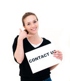 Young woman with board contact us Stock Images