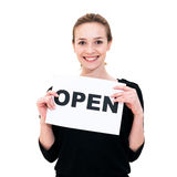 Young woman with board OPEN Royalty Free Stock Photography