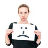 Young woman with board sad emoticon face sign Royalty Free Stock Photography